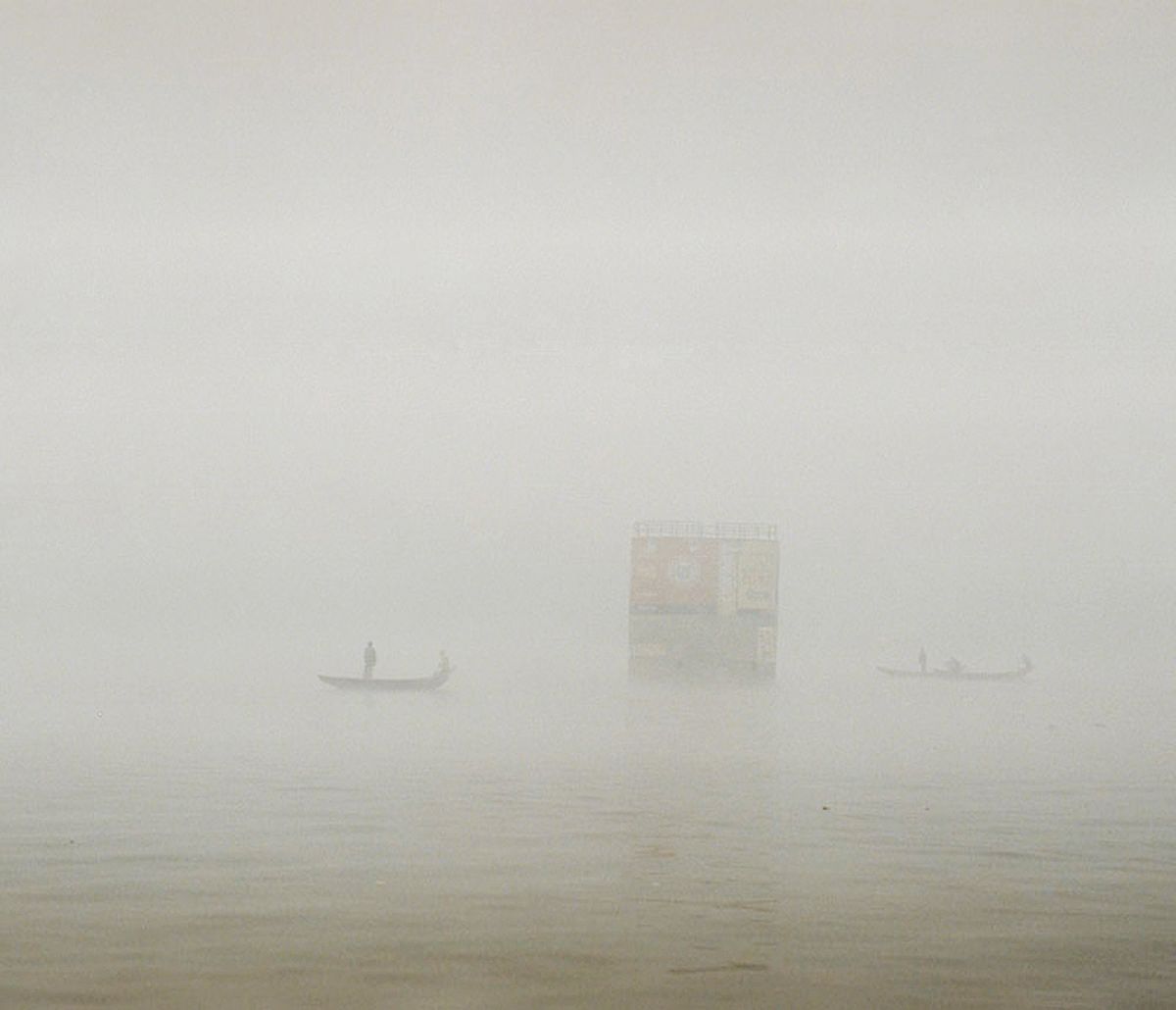 Peoples are crossing river though it is very risky because of heavy fog in winter.
