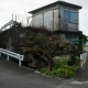 Nanjo, June 14, 2013: A house nestled next to a cave