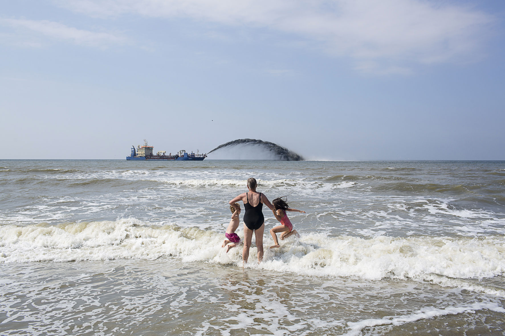 Swimming in the North Sea where at the same time new sand is being laid for protection of the Dutch coast.